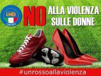 """Calciatori campani in campo con simbolo disegnato in volto per """"dare un rosso"""" alla violenza sulle donne"""